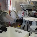 Inserting Bottles into machine