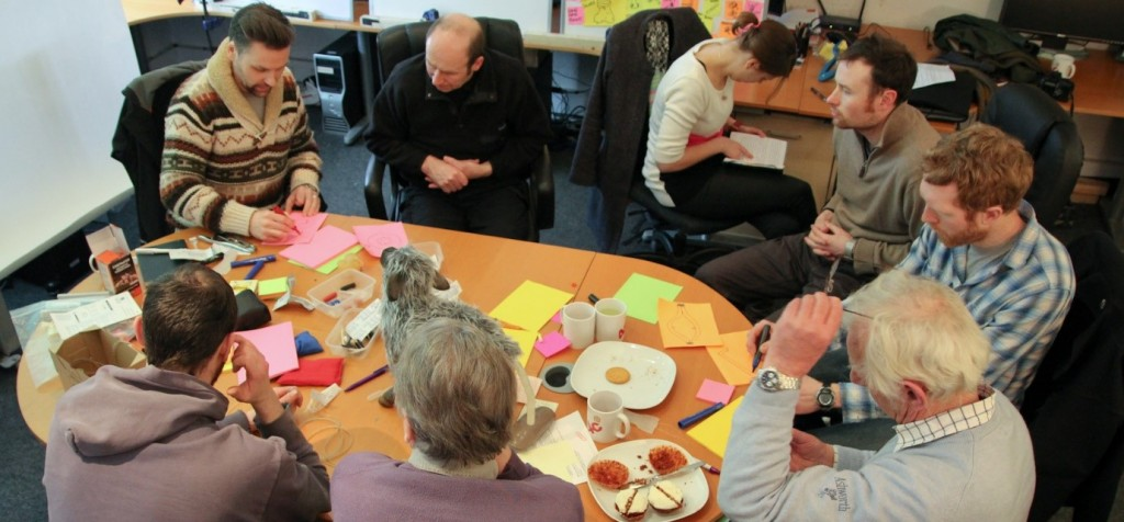 Photograph of 4c Design and collaboration partners brainstorming ideas for the Numnuts project